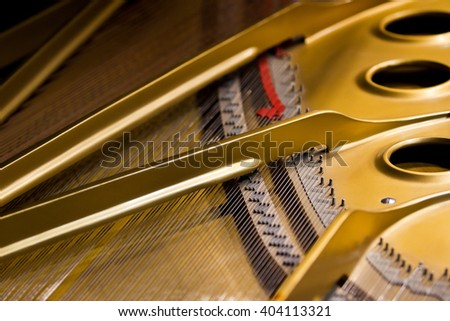 The strings of the piano closeup - stock photo