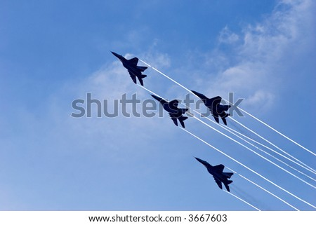 The Strizhi aerobatic team at air show at St.Petersburg, Russia (IMDS 2007). - stock photo