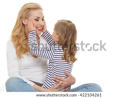 The strongest feeling. Horizontal shot of a little girl sitting on her mothers lap and touching her face copyspace on the side on white background. - stock photo