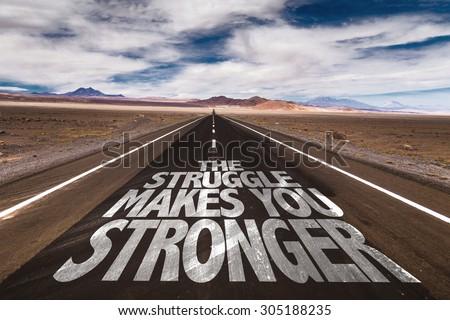 The Struggle Makes You Stronger written on desert road - stock photo
