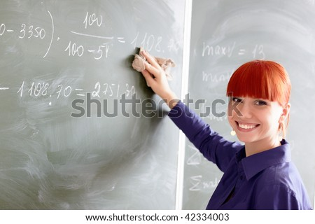The student near a school board - stock photo