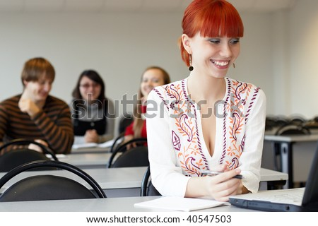 The student on employment in a class room sits at a table - stock photo
