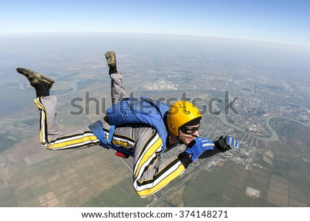 The student performs the task skydiver in freefall. - stock photo
