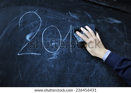 the student writes on a board with a white chalk - 2014 - stock photo