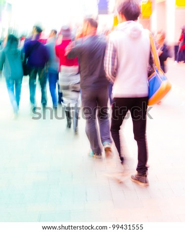 the students walking on campus in intentional motion blur - stock photo