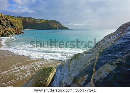 The stunning Cornish beach, granite rock formation and coast line of Lantic Bay near Polruan in winter time, Cornwall, England, United Kingdom - stock photo