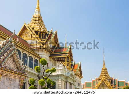 The stunning Royal Palace in Wat Phra Kaew temple, which is Bangkok most important Buddhist temple and one of the main landmark in Thailand capital city. - stock photo