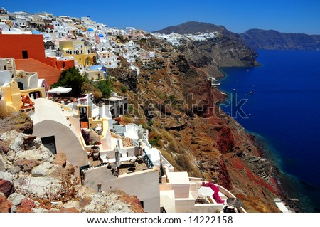The stunning village of Oia hanging from the cliffs in the volcanic island of Santorini, Greece - stock photo