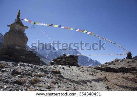 The stupa and praying flags in Nepal. - stock photo