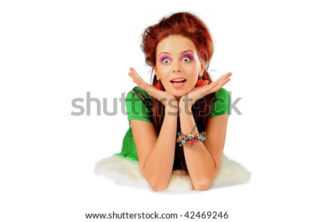 The stylish girl in a green dress isolated