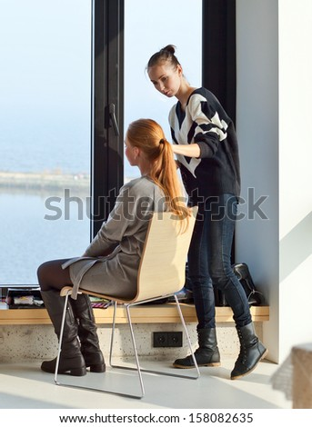 The stylist does a make-up for photosession