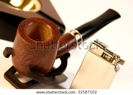 The Subjects for smoking: wooden tube, golden cigarette-lighter, ashtray. - stock photo