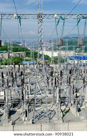 The Substation and  Power Transmission Lines three colors  on the town  background. - stock photo