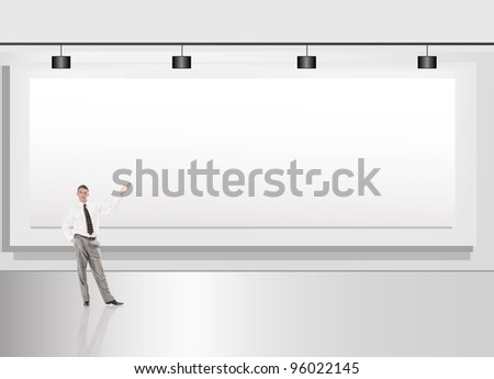 The successful businessman against an advertising billboard - stock photo