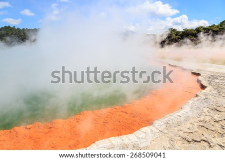 The sulfuric champagne pool with steam in the geothermal wonderland Wai-o-Tapu near Rotorua, New Zealand - stock photo