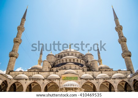 The Sultan Ahmet Mosque (Blue Mosque) close up front view from the courtyard in Istanbul, Turkey - stock photo