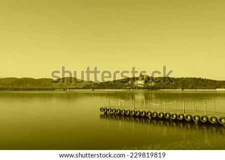 The Summer Palace, Beijing, December 10th: dock and the tower of Buddhist incense in Kunming Lake, in the Summer Palace on December 10, 2011, Beijing, china.  - stock photo