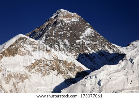 The summit pyramid of Mount Everest, in the Nepal Himalaya - stock photo