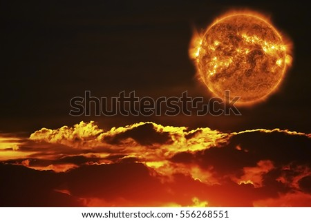 The Sun and The Sunset Sky.Element of the Sun image furnished by NASA.