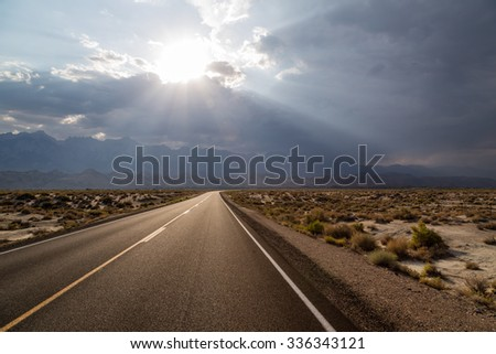 the sun breaks through - on the road to Bishop, California - stock photo