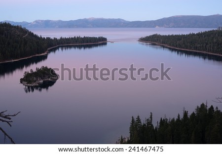 The sun has set leaving purple muted hues on Emerald Bay - stock photo