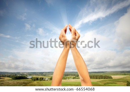 The sun in hands - stock photo
