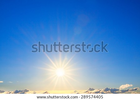 the sun in the blue sky - stock photo