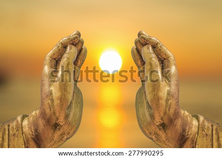 The Sun in The Buddha hands abstract Religion gives light to everyone in the world.  - stock photo