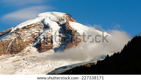 The sun is ready to set casting long shadows at Mt Baker - stock photo