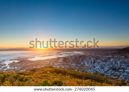 The sun is rising over the distant Durbanville Hills, just outside of Cape Town. At this perfect moment everything seems still and calm. - stock photo