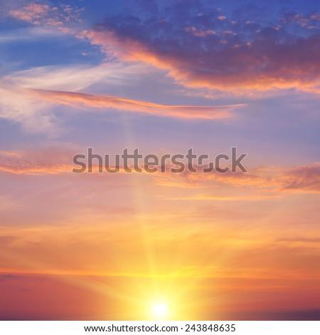 the sun rays illuminate the sky above the horizon - stock photo