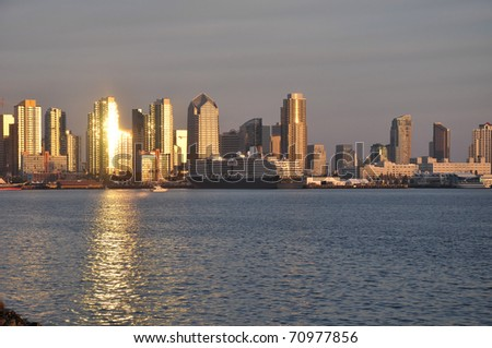 The sun reflects off of a downtown tower in San Diego, California. - stock photo