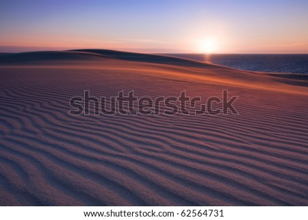 the sun rises in the desert - stock photo