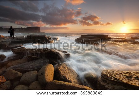 The sun rises on 2016.  New Years Day at Avalon Beach with views north and foreground tidal flows over rocks