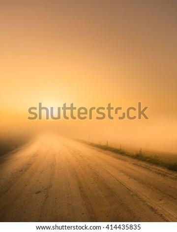 The sun rises over heavy fog - stock photo