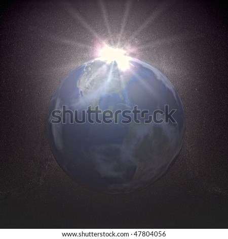 The sun rising over the earth - stock photo