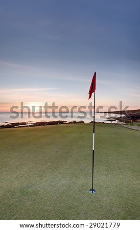 The sun rising over the sea from the new Castle Course in St Andrews. - stock photo