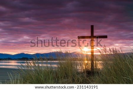 The sun's morning ray give hope for a new day and the hope of salvation. - stock photo