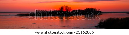 The sun sets on frozen Wild Rice Lake in Northern Minnesota