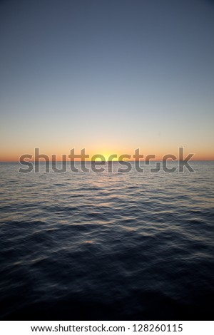 The sun sets on the calm, warm waters of the Caribbean Sea.  The Caribbean has the highest marine diversity in the Atlantic Ocean.