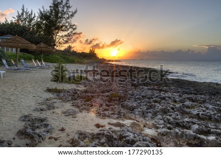 The sun sets over Boatswains Bay on the north side of Grand Cayman, Cayman Islands, BWI - stock photo