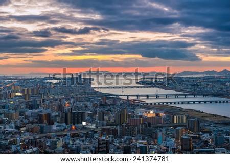 The sun sets over Osaka, Japan. - stock photo