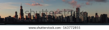 The sun sets over the Chicago skyline - stock photo