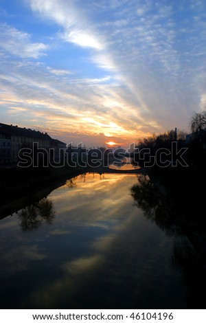 The sun setting over the River Timisoara Romania.