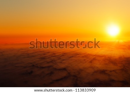 The sun shining above the clouds. - stock photo