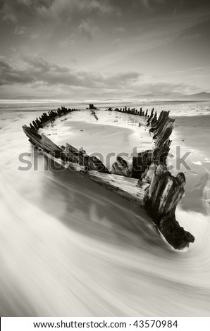 The Sunbeam wreckage on the Rossbeigh Strand in Kerry,Ireland - stock photo