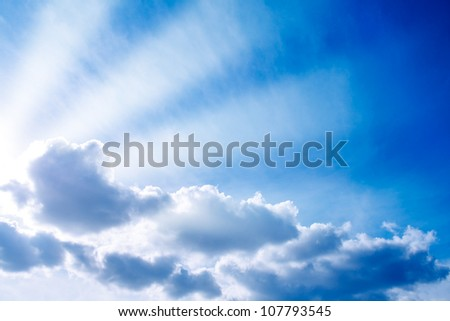 The sunbeams lighting through clouds. - stock photo
