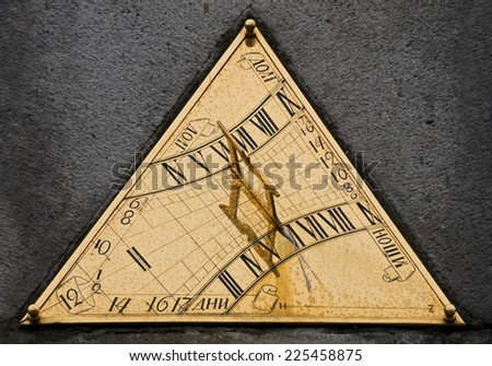 The sundial made of brass close up. The ancient device for measurement of time being in Sergiyevy Monastery in Russia. - stock photo