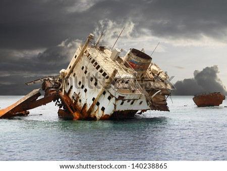 The sunken shipwreck on the reef, Egypt, Red Sea. - stock photo