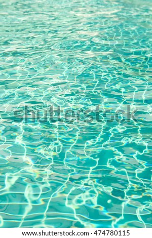 The sunlight on the surface of the water in the pool dimensional waves on water.